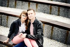 Young couple in love hugging on the bench. Royalty Free Stock Image