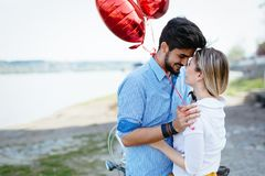 Young couple hugging dating and kissing outdoor. Young couple in love hugging dating and kissing outdoor Stock Image