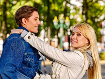 Young couple in love hugging and flirting in autumn park. Stock Image