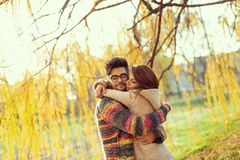 Couple hugging in the park stock image