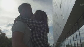Young couple in love hugging and kissing on the street. stock video footage