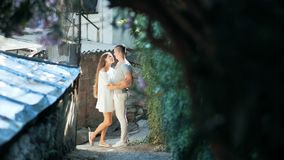 Young couple in love, hugging in the old part of town.  stock video footage