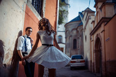 Young couple in love, hugging in the old part of town Royalty Free Stock Image