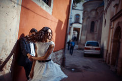 Young couple in love, hugging in the old part of town Stock Photo