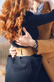 Young couple in love hugging in the street in the city Stock Images