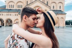 Young couple in love, hugging on the street. Stock Images