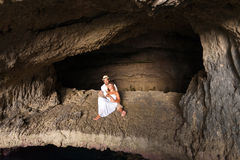 Young couple in love inside a cave Royalty Free Stock Image