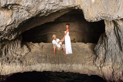 Young couple in love inside a cave Royalty Free Stock Images