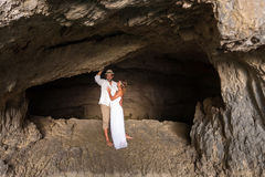 Young couple in love inside a cave Royalty Free Stock Photography