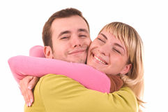 Young couple in love isolated on white. Young couple in love (isolated on white) hugging royalty free stock image