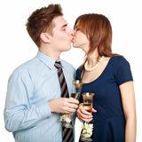 Young couple in love kiss, celebrating a date Royalty Free Stock Images