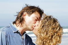 Young couple in love kissing eachother Stock Images