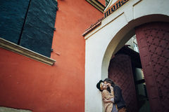 Young couple in love, kissing near vintage metal door stock photo
