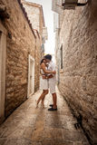 Young couple in love kissing on old narrow street Royalty Free Stock Photography