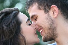 Young Couple in Love, Kissing, Outdoors. Young couple in love, outdoors - urban /  street setting, posing and having fun Royalty Free Stock Photography