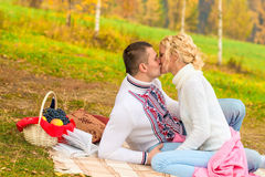 Young couple in love kissing on a picnic Stock Photography