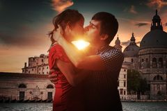 Young couple in love is kissing in Venice in Italy royalty free stock images