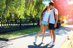 Young couple in love kissing walking in city park at summer Stock Photo