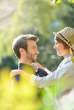 Young couple in love looking at each other. Young couple in love embracing in park Royalty Free Stock Images