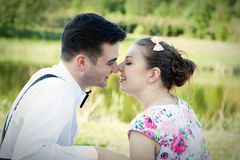 Young couple in love looking at each other. Summer park Royalty Free Stock Photography