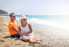 Young couple in love lying on the beach, enjoying.  stock image