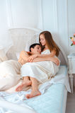 Young couple in love lying in bed Royalty Free Stock Photography