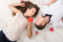Young couple in love lying on floor, top view Stock Image