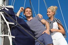 Young couple in love makes holiday on a sailboat Royalty Free Stock Image