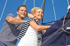 Young couple in love makes holiday on a sailboat Stock Image