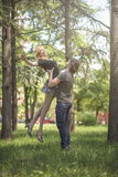 Young couple in love, man taking his girlfriend in the air Royalty Free Stock Photo