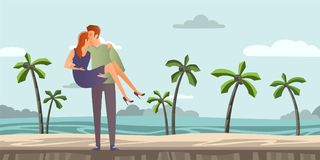 Young couple of lovers. Man and woman on a romantic date on a tropical beach with palm trees. A man carries a woman on Royalty Free Stock Image