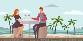 Couple in love. Young man and woman on a romantic date on a tropical beach with palm trees. Romantic dinner by the sea Stock Photo