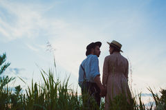 Young couple in love in the meadow Royalty Free Stock Photography