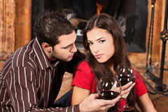 Couple in love near fireplace Royalty Free Stock Photography