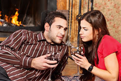 Couple in love near fireplace Stock Photography