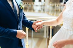 Young couple in love newlyweds exchange gold wedding rings 1. Young couple in love newlyweds exchange gold wedding rings royalty free stock photos