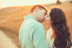 Young couple in love outdoor.Couple hugging and kissing. Royalty Free Stock Photos