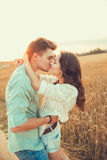 Young couple in love outdoor.Couple hugging and kissing. Young couple in love outdoor.Stunning sensual outdoor portrait of young stylish fashion couple posing Stock Image