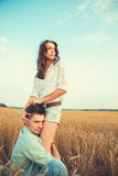Young couple in love outdoor.Couple hugging. Young couple in love outdoor.Stunning sensual outdoor portrait of young stylish fashion couple posing in summer in Royalty Free Stock Images