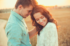 Young couple in love outdoor.Couple hugging. Young couple in love outdoor.Stunning sensual outdoor portrait of young stylish fashion couple posing in summer in Stock Image