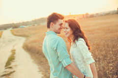 Young couple in love outdoor.Couple hugging. Young couple in love outdoor.Stunning sensual outdoor portrait of young stylish fashion couple posing in summer in Stock Photos