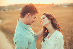 Young couple in love outdoor.Couple hugging. Young couple in love outdoor.Stunning sensual outdoor portrait of young stylish fashion couple posing in summer in Royalty Free Stock Photos