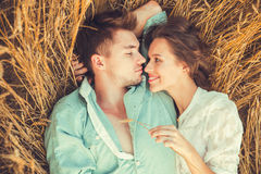Young couple in love outdoor.Couple hugging.Young beautiful couple in love staying and kissing on the field on sunset. Young couple in love outdoor.Stunning Royalty Free Stock Photos