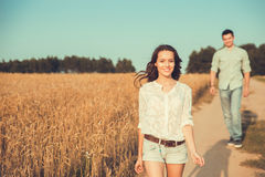 Young couple in love outdoor.Couple runs across the field. Young couple in love outdoor.Stunning sensual outdoor portrait of young stylish fashion couple posing Royalty Free Stock Images