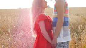 Young couple in love outdoor at field stock footage