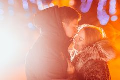 Young couple in love  outdoor filtered photo with flash flare Royalty Free Stock Images
