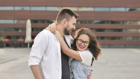 Young couple in love outdoor. Portrait of young woman and man embracing at sunset. Young couple in love outdoor. Portrait of young woman and man embracing at stock video footage