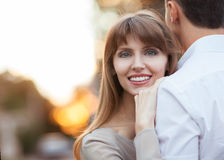 Young couple. In love outdoor. She pressed against him, he is a gentle hugs her Stock Photos