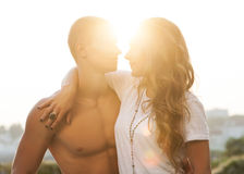 Young couple in love outdoor. Romantic young couple enjoying sun, sunshine, romance and love Royalty Free Stock Image