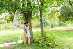 Young couple in love outdoor. Sensual outdoor portrait of young stylish fashion couple posing in summer nature Royalty Free Stock Images